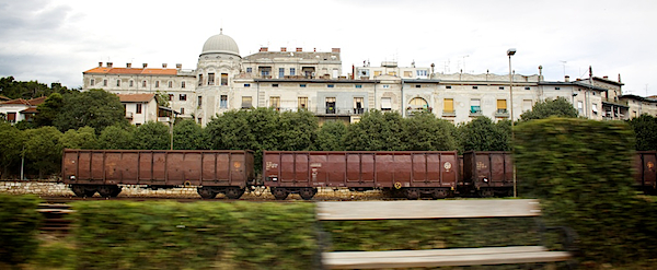 train in front of a villa and bushes