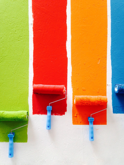 Paint rollers with colorful paint - white balance photography tips