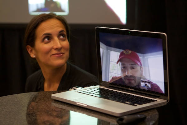 An image of a woman and a man on the laptop