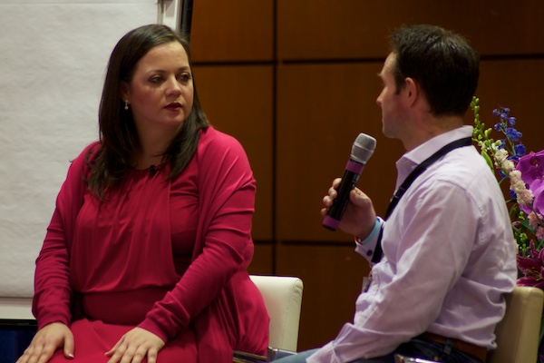 A guest and speaker conversing - Corporate Event Photography