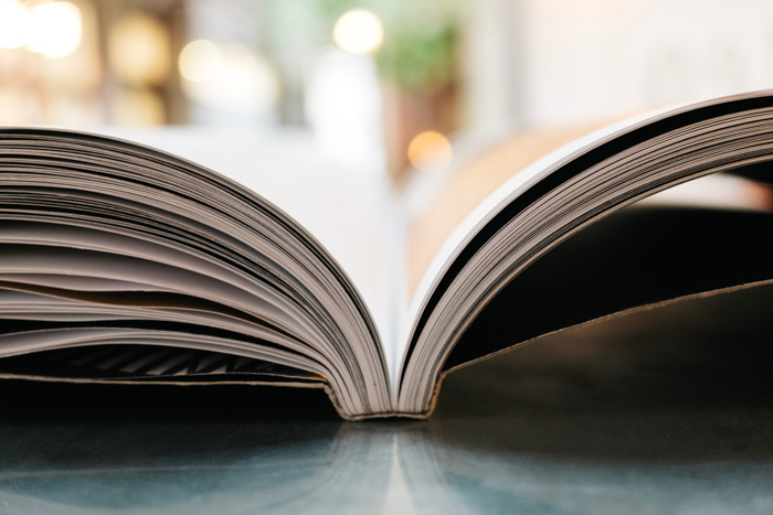 A close up of a photography book open on a table
