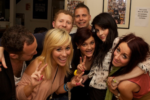 group of people smiling and having fun at a party
