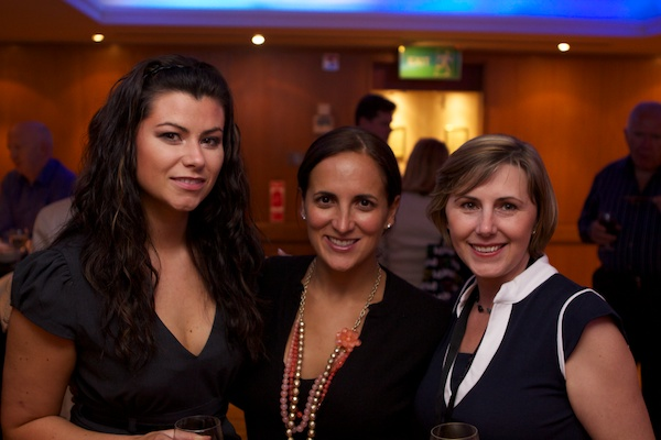 three woman smiling for a photo at an event