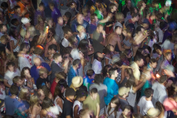 blurry photo of a crowd partying in a club
