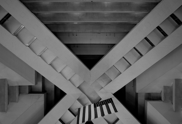 black and white photo of a building from below