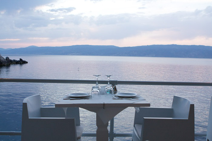 An outdoor dining table by the sea - natural light for photography