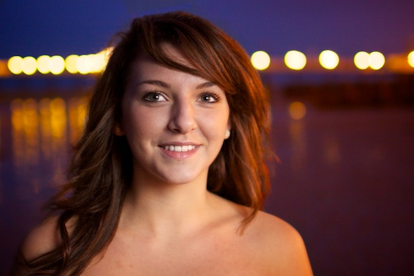 Portrait of a female model outdoors at night , using the definition brush during post processing