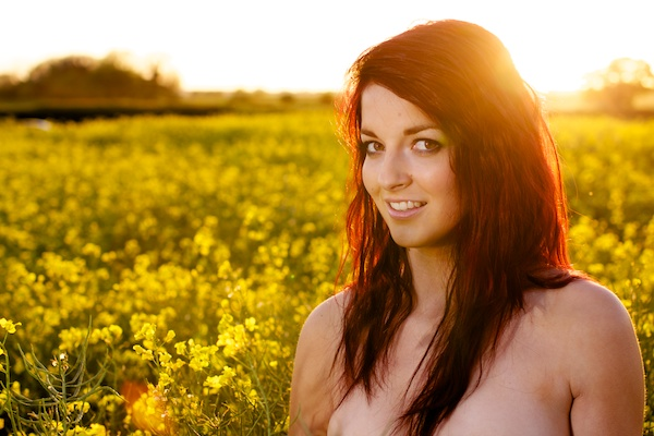 Photo of a young woman in the field of yellow flowers demonstrating editing with black point