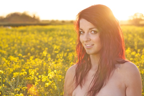 Photo of a young woman in the field of yellow flowers demonstrating editing with shadows