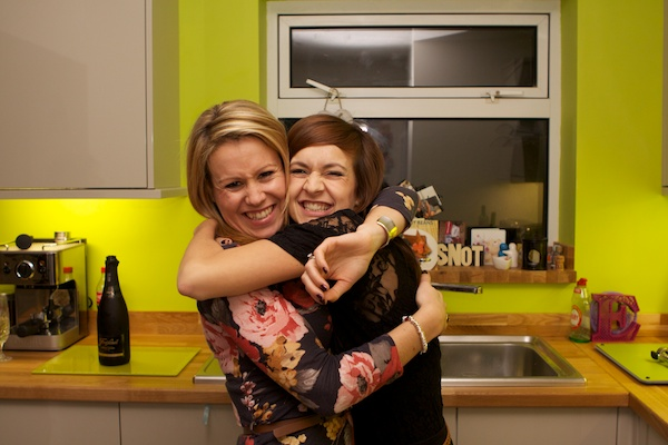 Cute portrait of two friends hugging at a party