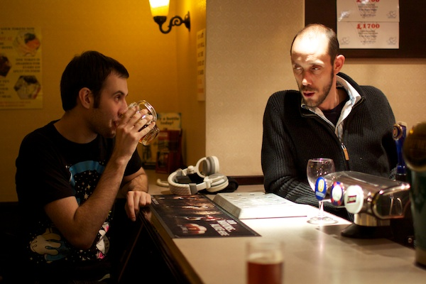 Photo of two men looking at each other in a bar