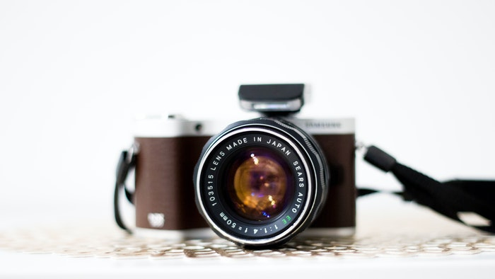 Brown camera with a prime lens