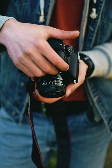 A photographer loking at his DSLR camera