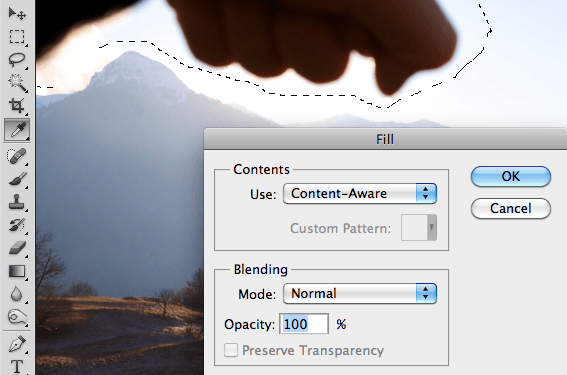 photoshop processing to remove a hand from a photograph