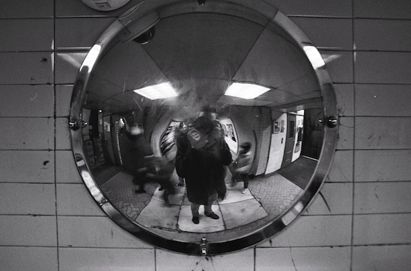 A self portrait in a mirror - black and white street photography