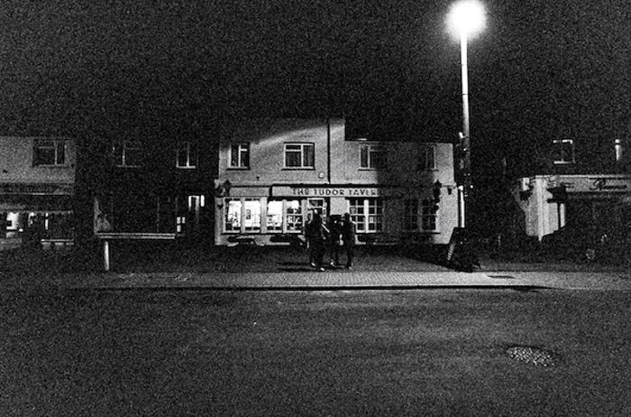 A dark grainy street photography shot