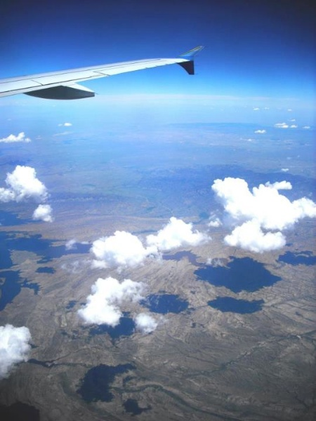 An image from a plane window overlooking plains. High Angle – 30 Day Photography Challenge Tips