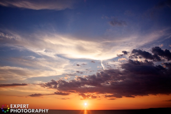 A sunset image showing clouds