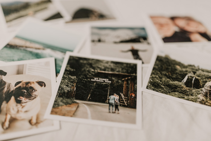 An overhead shot of polaroid photos on a white background