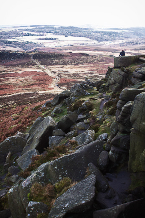 A rocky landscape photo containing a path