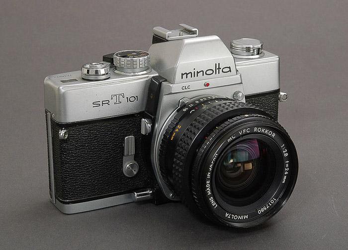 Minolta SRT-101 classic vintage camera on grey background