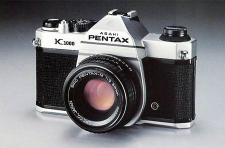 Pentax classic film camera on grey background