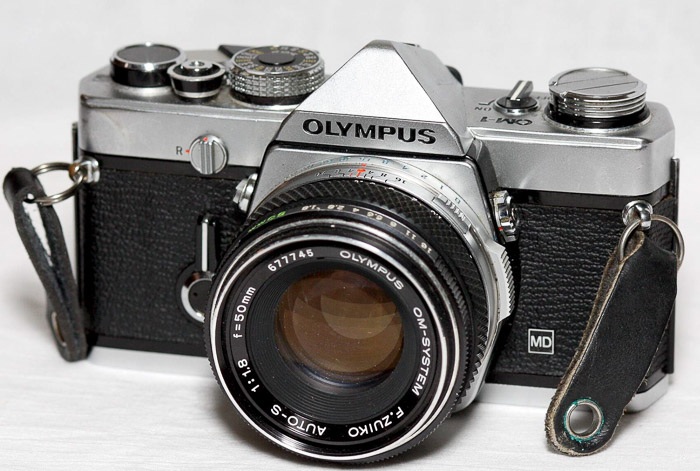 Classic Film Camera - Olympus OM-1 MD on white background