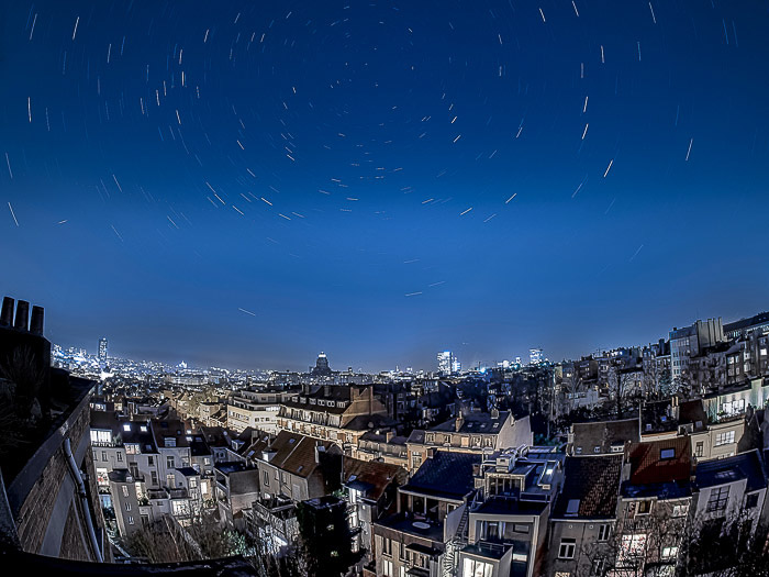 A stunning shot of the night sky over a cityscape