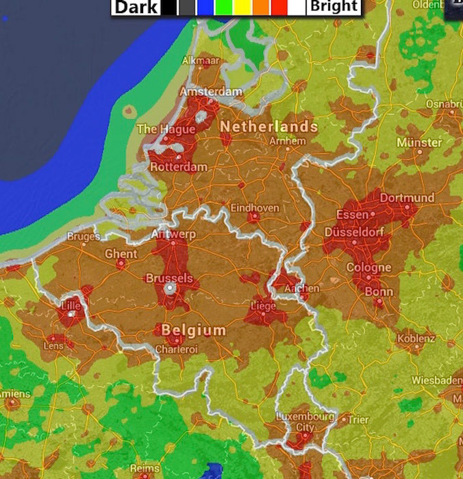 A light pollution map for Belgium: brighter areas are in red while the darker ones are in black