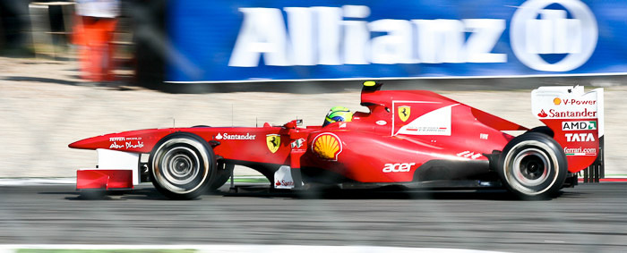 A red race car at the 82th Italian GP in Monza featuring creative motion blur