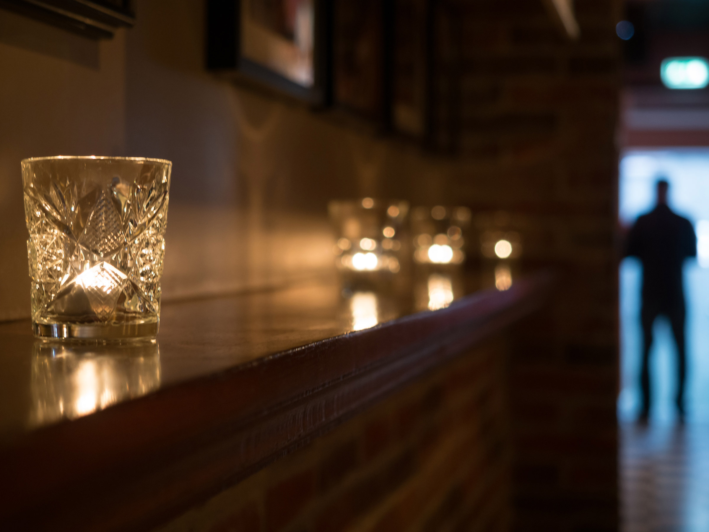 shallow focus of candles on a ledge