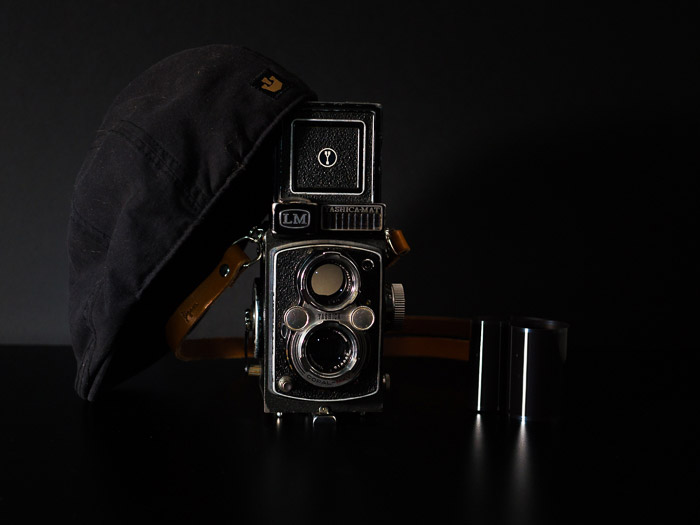 A Yashica-MAT LM TLR 6X6 medium format camera, on a black background