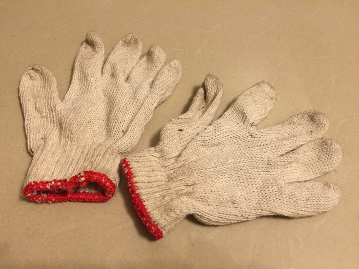 a pair of gloves on white background