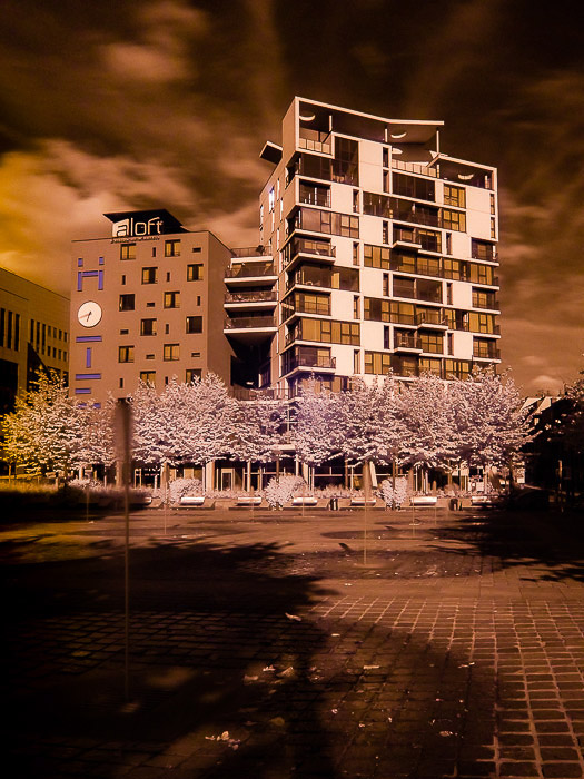An amber tinted infrared photography shot of The aloft Hotel in Brussels (Belgium).