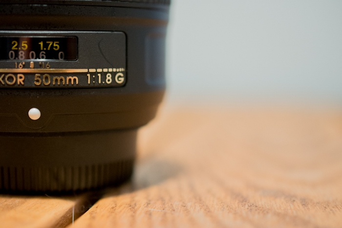 close-up of 50mm prime lens on table