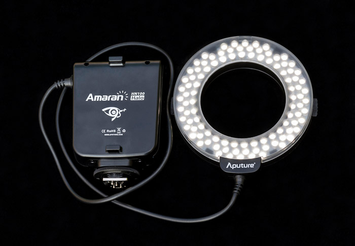 A ring flash unit for portrait lighting on black bacckground
