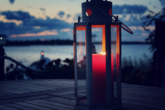 Example of twilight photography during the blue hour: candle lantern on table