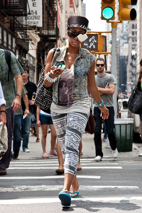 Street photography of a woman walking through a busy urban area - candid photography tips