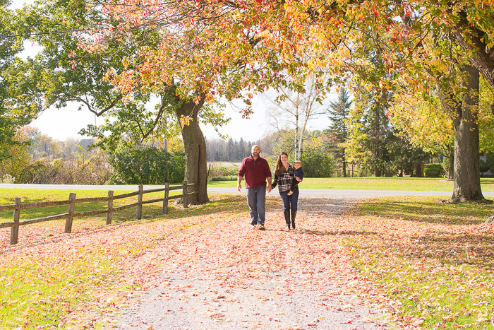 Family Portrait ideas of a couple walking casually through a scenic space