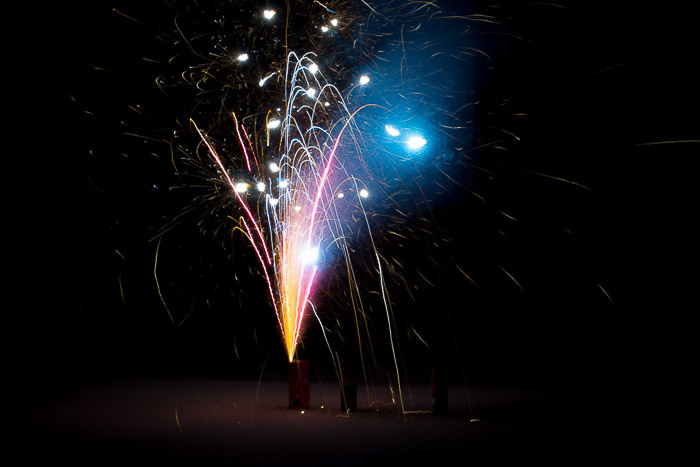A multicolor mine firework erupting, fireworks photography tips