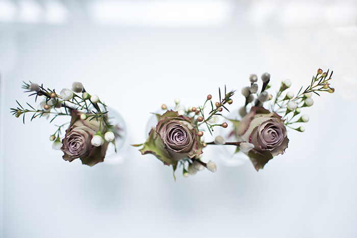 Photographing wedding details: Buttonhole flowers with blurred background