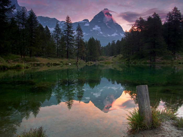 landscape image of Matterhorn peak in the Alps mountains with lake reflection at the front