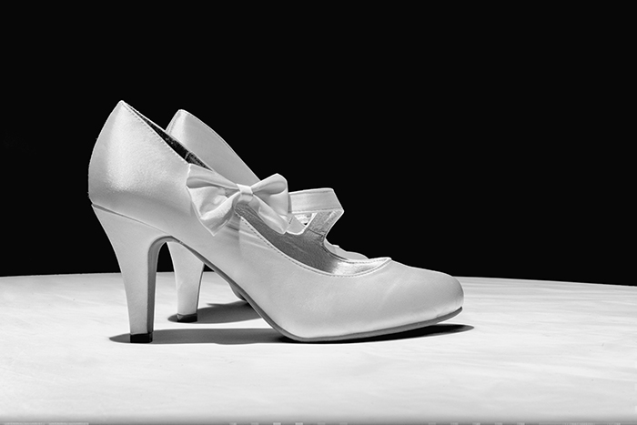 Photographing wedding details: Black and white shot of wedding shoes