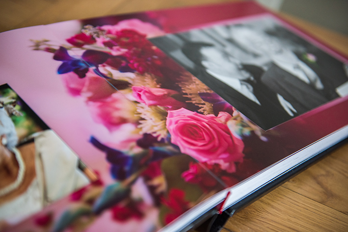 An open wedding photo album in landscape format