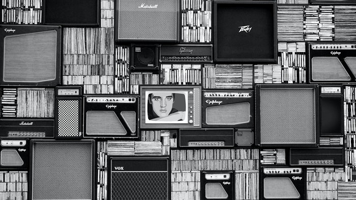 black and white image of old speakers and books