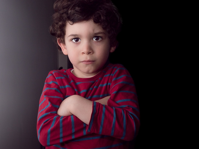 Portrait of young boy taken with on-camera flash bounced off of a white wall