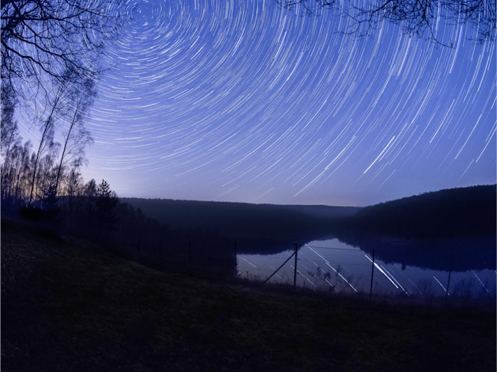 Blur the background in Lightroom: Star trail background with uninteresting foreground