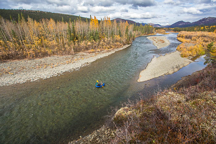 Adventure photography showing river rafting from a distance