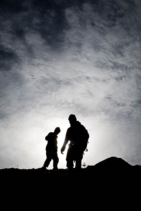 The silhouettes of two men photographed at Katakturuk River