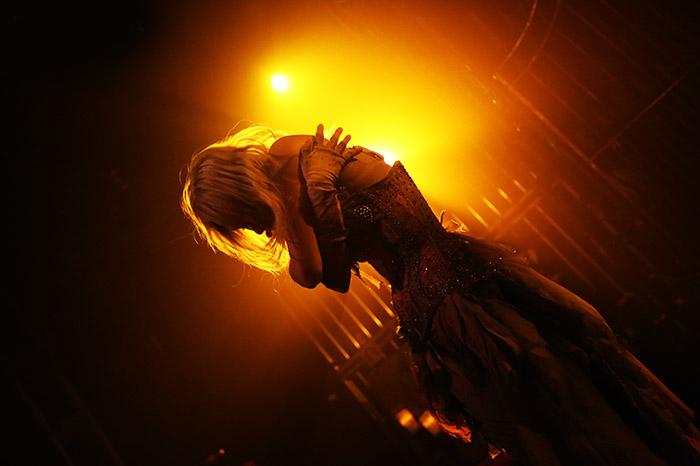 Emilie Autumn - Portrait against orange light.